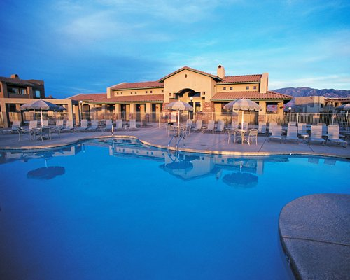 Exterior view of WorldMark Tucson Rancho Vistoso with an outdoor swimming pool.