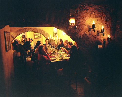 A group of people in the indoor fine dining restaurant at Borgo di Vagli resort.