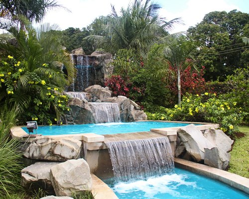 An outdoor grotto pool.