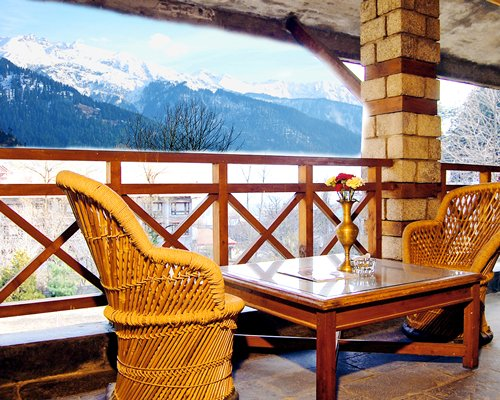 Outdoor dining with view of mountains during winter.