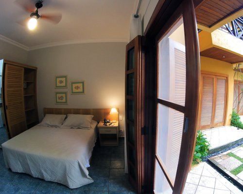 A well furnished bedroom with outdoor patio.