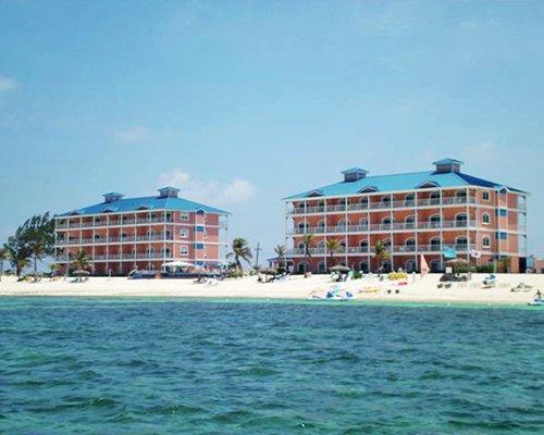 Exterior view of Morritt's Grand Resort alongside the sea.