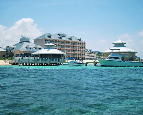 A view of boats and resort units from the sea.