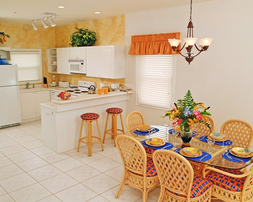 A well equipped kitchen and dining area with a breakfast bar.