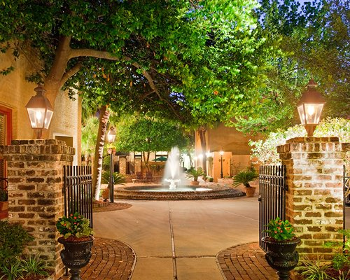 Pathway and entrance to The Lodge Alley Inn with fountain and landscaping.