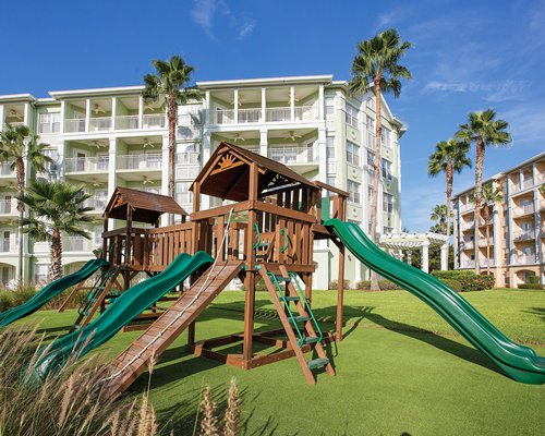 View of multiple unit balconies at Kingstown Reef with kids playscape.