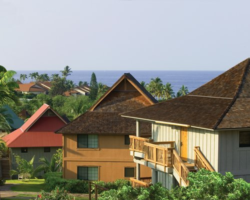 Scenic exterior view of units at Wyndham Kona Hawaiian Resort alongside the ocean.