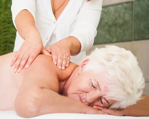 A lady enjoying a massage.