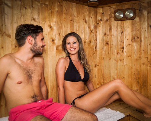 A couple relaxing in the sauna at Holiday Club Heviz resort.