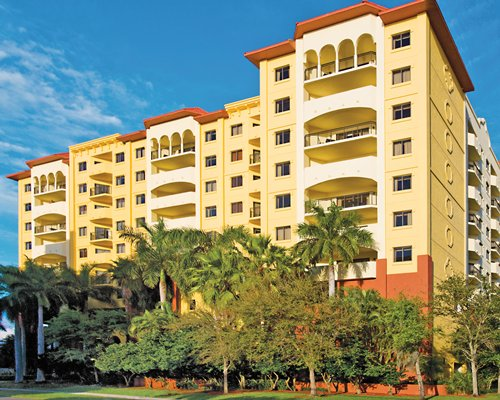 Scenic exterior view of Wyndham Ocean Palms with multiple balconies.