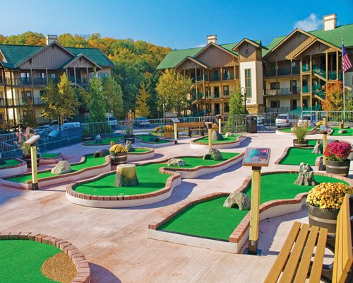 An outdoor recreation area with mini golf course alongside multiple units.