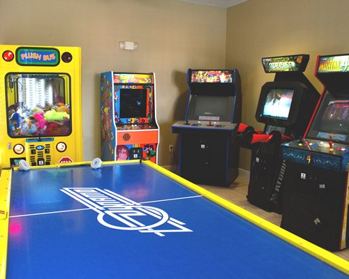 An indoor recreation room with the arcade machines.
