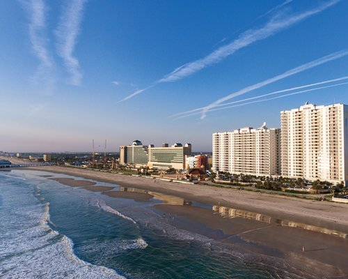 A ground view of the multi story Wyndham Ocean Walk resort.