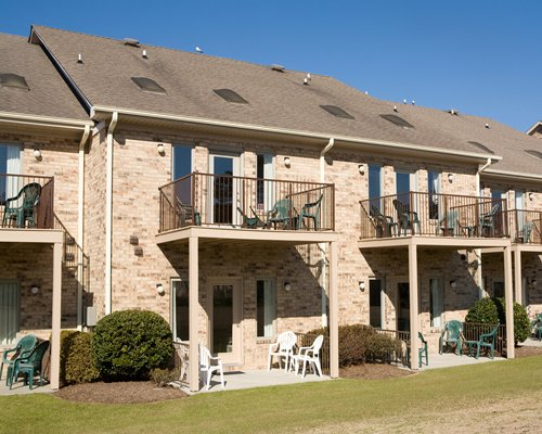 Scenic exterior view of Plantation Resort Villas with multiple balconies and patio chairs.