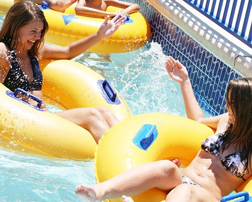 A recreational room with arcade games and pool tables.