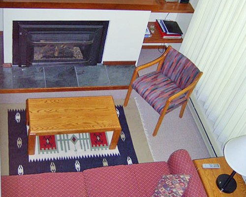 A well furnished living room with a fireplace.