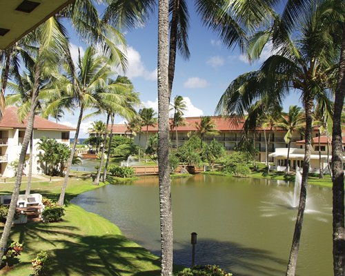 Exterior view of MROP at Kauai Beach Villas with waterfront and fountain.