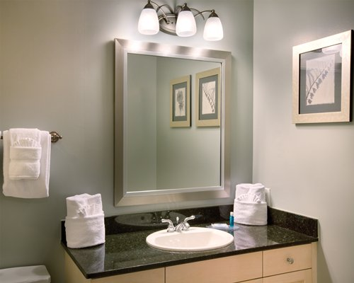 A bathroom with a single sink vanity.