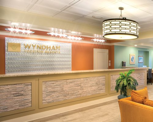 Reception and lounge area at Wyndham Vacation Resorts At Majestic Sun.