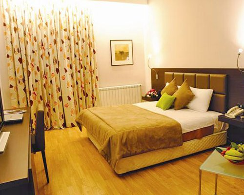 A well furnished bedroom with a queen bed.
