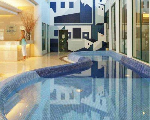 An indoor pool alongside the well furnished reception area.