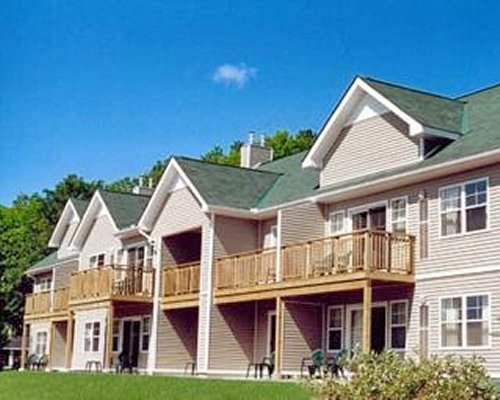 Exterior view of GEOHoliday at Haliburton Heights with balconies surrounded by wooded area.
