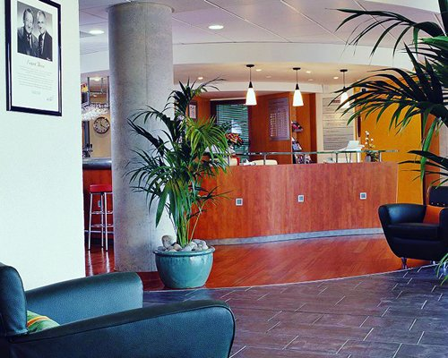 The reception and lounge area at Novotel Suites Paris Montreuil.