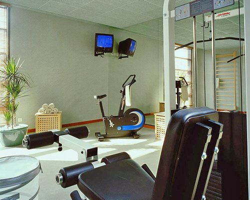 An indoor fitness center with a television.