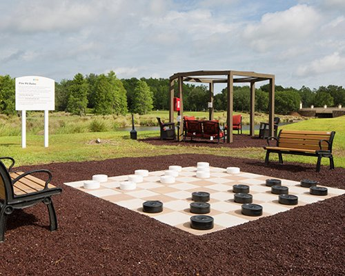 A view of giant chess board alongside picnic area.