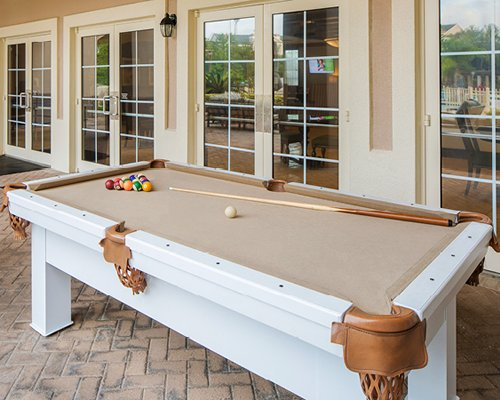 Outdoor recreation area with pool table.