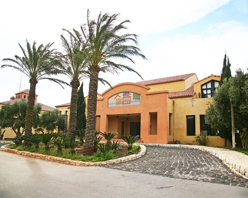 Scenic exterior view and entrance of Batroun Village Club with a pathway.