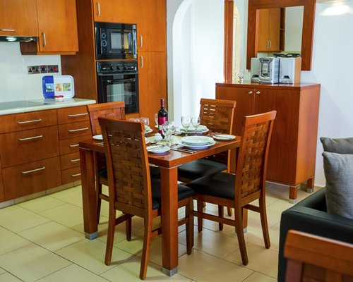 A well equipped open plan kitchen with a dining area.