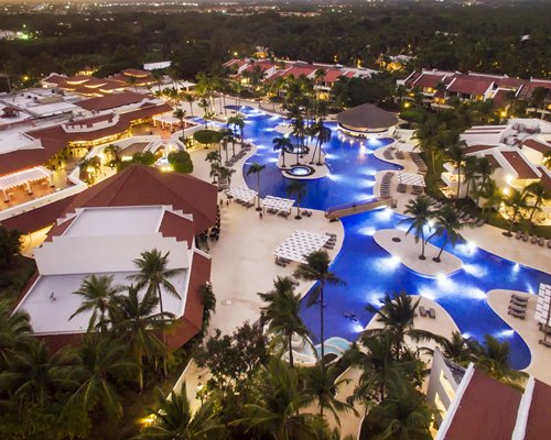 An aerial view of the resort with pool at night.