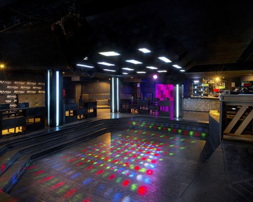 Dance club and bar with lighting effects.