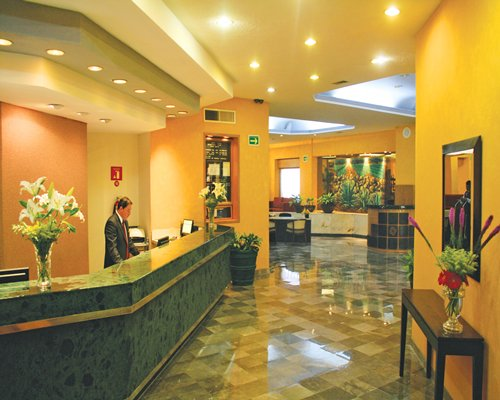 Reception and lounge area Hotel & Suites Guadalajara Plaza Lopez Mateos.
