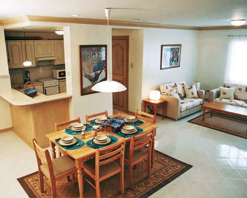 An open plan living and dining area alongside kitchen.