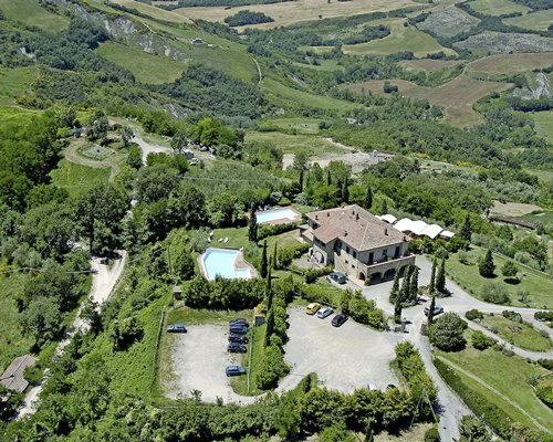 An aerial view of Il Poggio surrounded by wooded area.