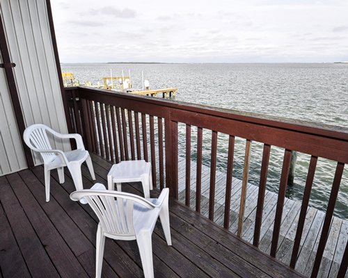 Balcony with patio furniture facing the ocean.