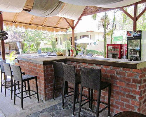 An outdoor bar with patio furniture.