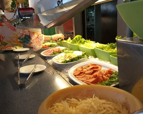 An outdoor water park with raining mushroom umbrella at All Ritmo Cancun Resort.