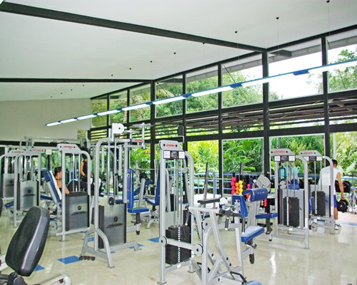An indoor fitness center with an outside view.
