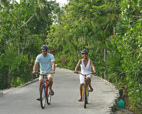 A couple riding the bicycle.
