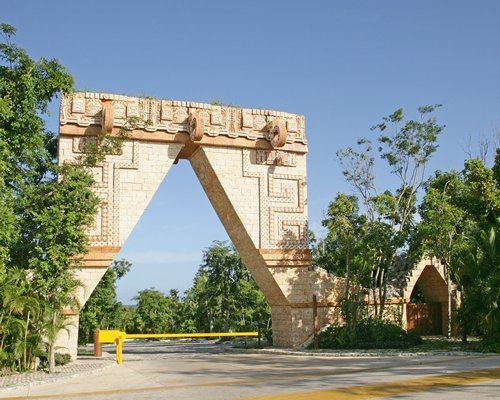 Scenic entrance to the Bel Air Collection Riviera Maya resort.