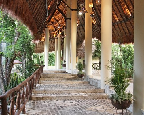 An outdoor staircase with thatched sunshade.