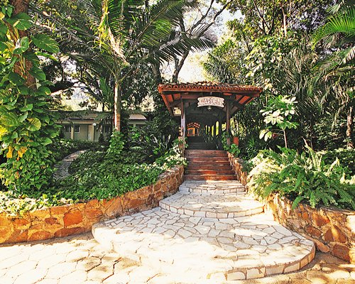 A scenic pathway leading to the Rio Quente Vacation Villa resort unit.