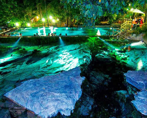 An aerial view of the outdoor swimming pool at night.