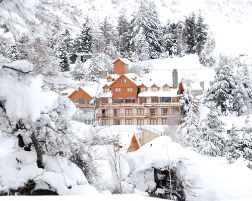 A view of the Hosteria del Cerro resort covered in snow.