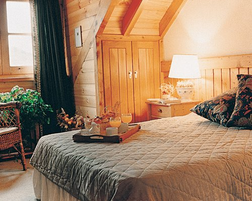 A well furnished wooden themed bedroom.