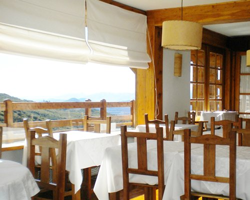 A fine dining area of the Hosteria del Cerro resort with an outside view.