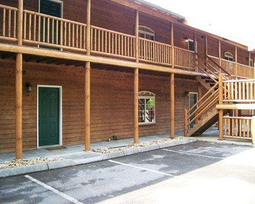 Exterior view of a unit at White Oak Lodge and Resort with balcony and stairway.